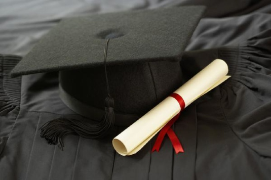 Cap gown and diploma