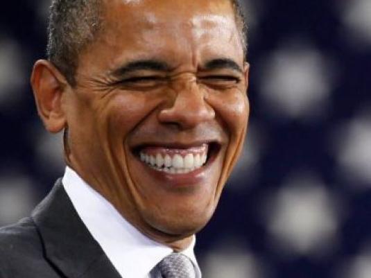Obama grinning four dollars 1