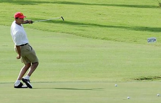 Obama playing golf - again