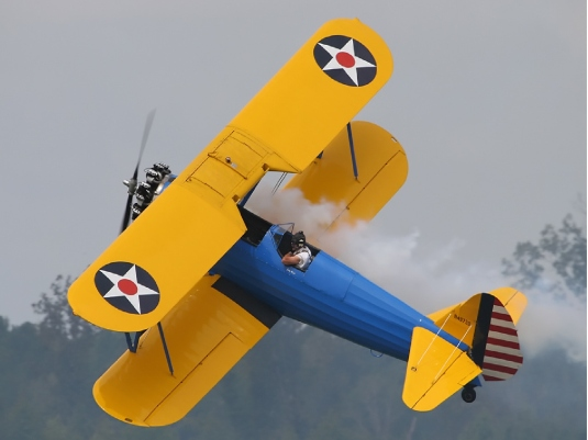 blue and yellow Stearman 2a