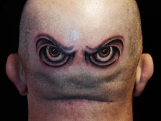 tattooed man three