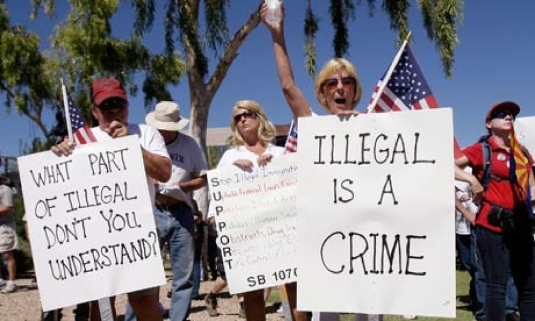 illegal is a crime - sign