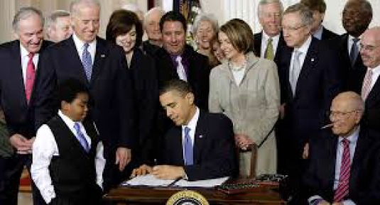 signing health care bill